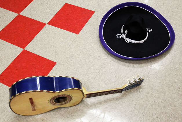 A vuhuela and sombrero wait on the floor in the dressing room while Mariachi Pantera from Jefferson Davis High School in Houston prepare for their performance in the Group Competition during the 18th annual Mariachi Vargas Extravaganza at  Lila Cockrell Theatre, Friday, November 30, 2012. Photo: JENNIFER WHITNEY / © Jennifer Whitney