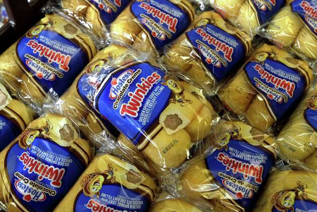In this Friday, Nov. 16, 2012, file photo, Twinkies baked goods are displayed for sale at the Hostess Brands' bakery in Denver, Colo. Photo: Brennan Linsley, Associated Press / Associated Press