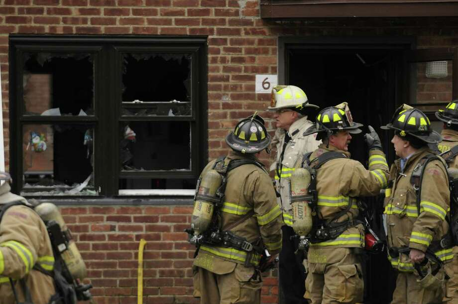 Troy Firefighters work a small fire at the Griswold Heights Apartments in Troy, NY Friday Nov. 30, 2012. (Michael P. Farrell/Times Union) Photo: Michael P. Farrell