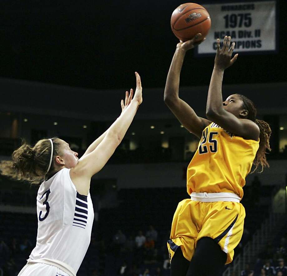 Cal's Gennifer Brandon, who had nine points and 17 rebounds, shoots over Old Dominion's Mairi Buchan. Photo: Jason Hirschfeld, Associated Press