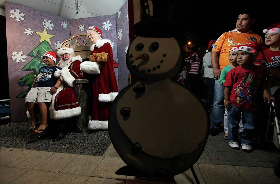 Children wait in line to take a photo with Santa and Mrs. Claus during the Mayor's 2012 Holiday Celebration and Tree Lighting at City Hall on Friday, Nov. 30, 2012, in Houston. Photo: Mayra Beltran, Houston Chronicle / © 2012 Houston Chronicle