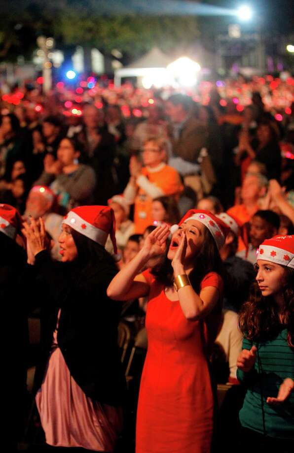 The audience claps for The Biohazard Brass Band from the 323d Army Band performs during the Mayor's 2012 Holiday Celebration and Tree Lighting at City Hall on Friday, Nov. 30, 2012, in Houston. Photo: Mayra Beltran, Houston Chronicle / © 2012 Houston Chronicle