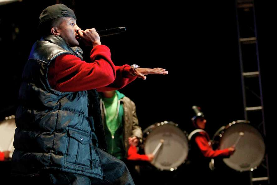 Rapper J. Xavier performs with MacArthur Jammin' Generals Drumline during the Mayor's 2012 Holiday C