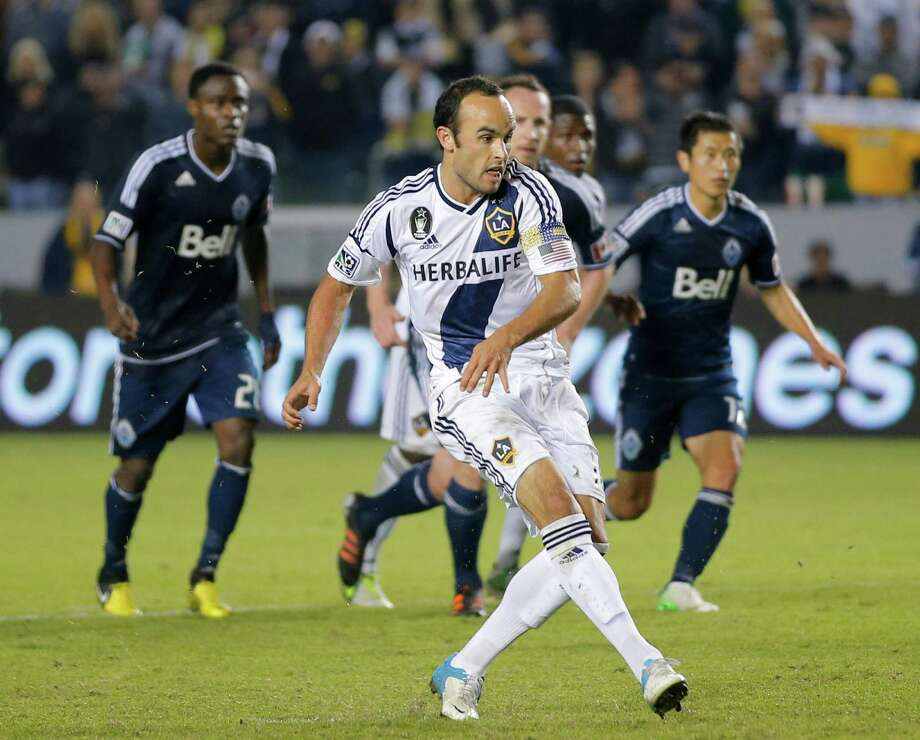 The Galaxy's Landon Donovan, center, will play in his sixth MLS Cup final. Photo: Jae C. Hong, STF / AP