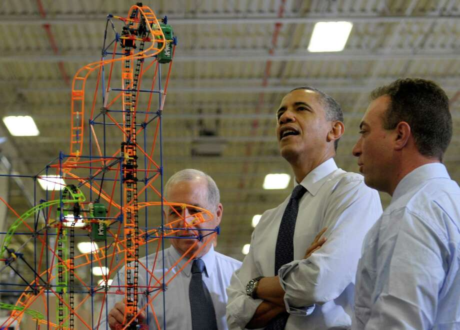 President Barack Obama looks over a rollercoaster with K'NEX Inventor Joel Glickman, left, and Rodon Group President and Chief Executive Officer Michael Araten, right, during a tour of the company in Hatfield, Pa. Friday, Nov. 30, 2012. The visit comes as the White House continues a week of public outreach efforts, while also attempting to negotiate a deal with congressional leaders. The Rodon Group manufactures over 95% of the parts for KiNEX Brands toys. (AP Photo/Susan Walsh) Photo: Susan Walsh
