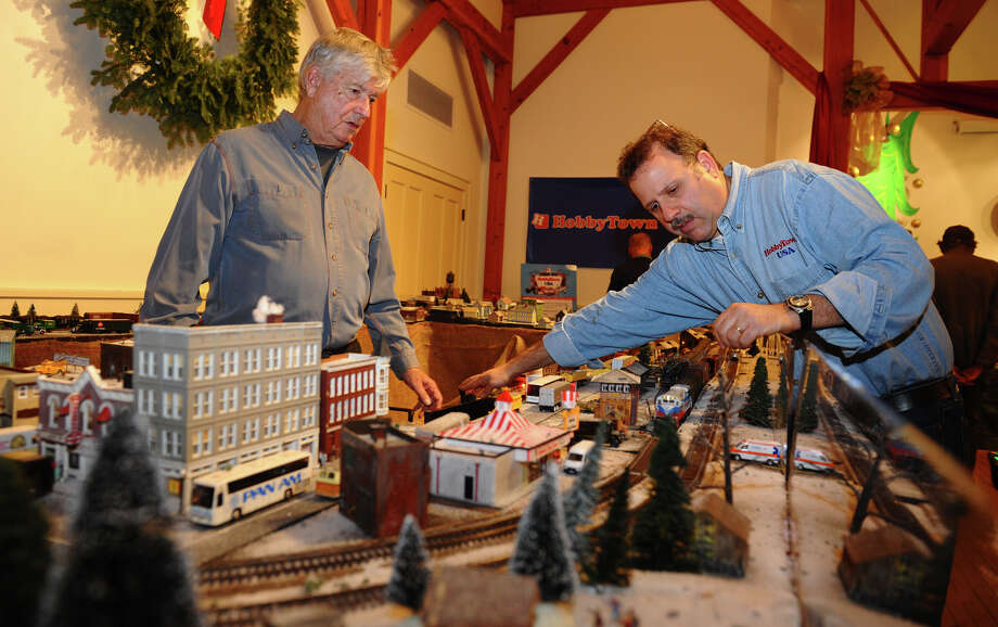 John Shannon, left, and Mark Rosenblum, work on making an HO Scale train run, during the annual Holiday Express Train Show at Fairfield Museum in Fairfield, Conn. on Friday November 30, 2012. Shannon is with the Housatonic Model Railroad Club, which helped put the event together. Rosenblum, who owns Hobby Town, USA as well as the Connecticut G-Scalers also worked to make the event possible. Photo: Christian Abraham / Connecticut Post