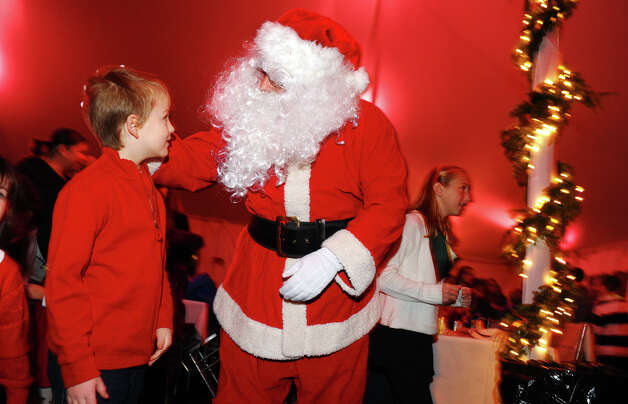 "Michael Terranova, 8, gets a little one on one time with Santa, during ""A Season We Share"" event at the annual Fairfield Christmas Tree Festival at Burr Homestead in Fairfield, Conn. on Friday November 30, 2012. Photo: Christian Abraham / Connecticut Post"