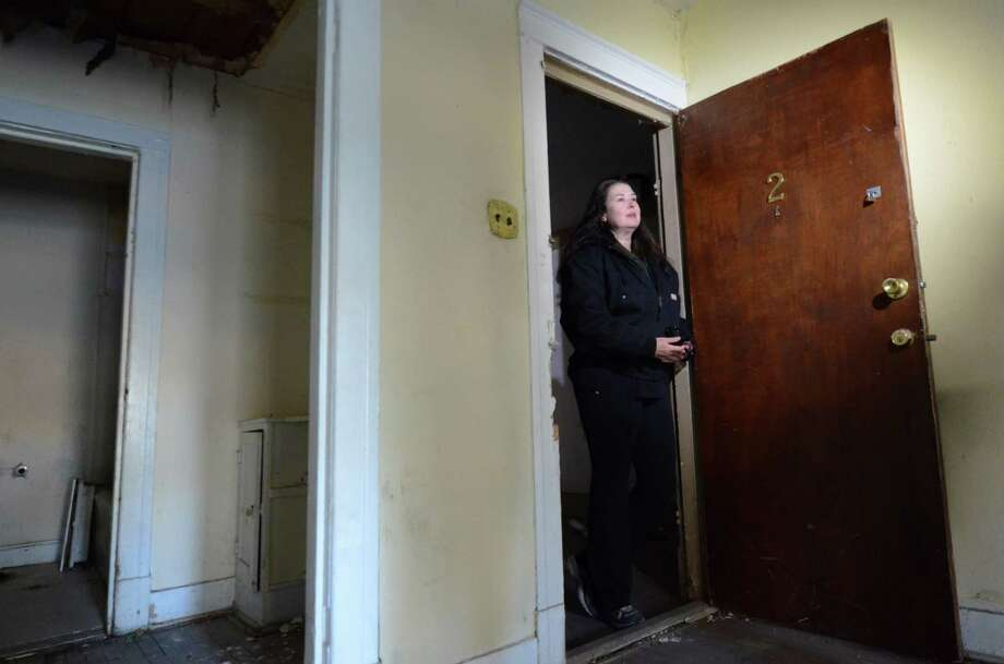 Jane Bryant stands in the doorway of the apartment where Lee Harvey Oswald lived from November 1962 to March 1963 in Dallas, Thursday, Nov. 29, 2012. Photo: Benny Snyder, Associated Press / AP