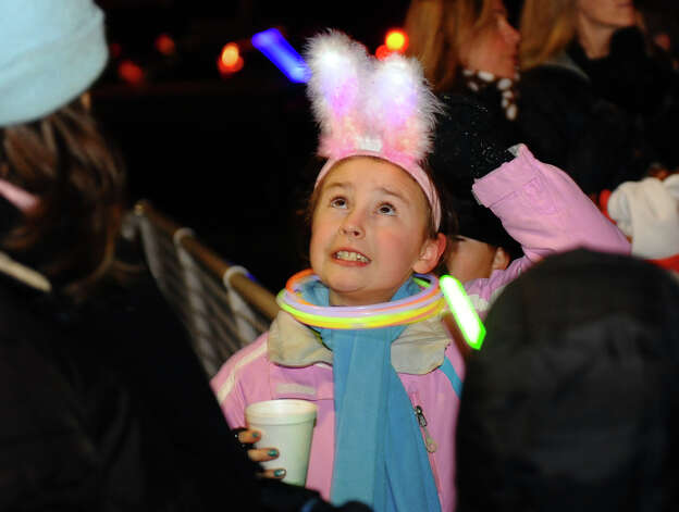 Lily Barlow, 8, checks to see if she turned on the lights in her bunny ears, during the annual Christmas Tree Lighting on the Town Hall Green in Fairfield, Conn. on Friday November 30, 2012. Photo: Christian Abraham / Connecticut Post