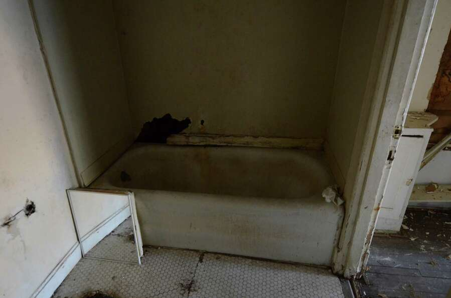 A decrepit bathroom is seen in Dallas, Thursday, Nov. 29, 2012, in the apartment where Lee Harvey Os