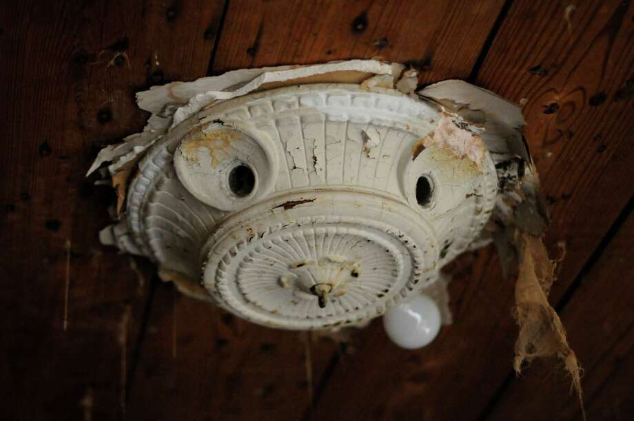 A decrepit light fixture hangs from the ceiling in Dallas, Thursday, Nov. 29, 2012, in the apartment building where Lee Harvey Oswald once occupied one of the units. Photo: Benny Snyder, Associated Press / AP