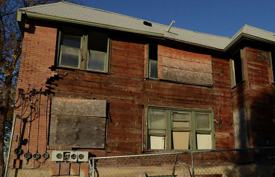 A decrepit facade is all that is left in the rear of  the apartment building in Dallas, Thursday, Nov. 29, 2012, where Lee Harvey Oswald once occupied one of the units. Photo: Benny Snyder, Associated Press / AP