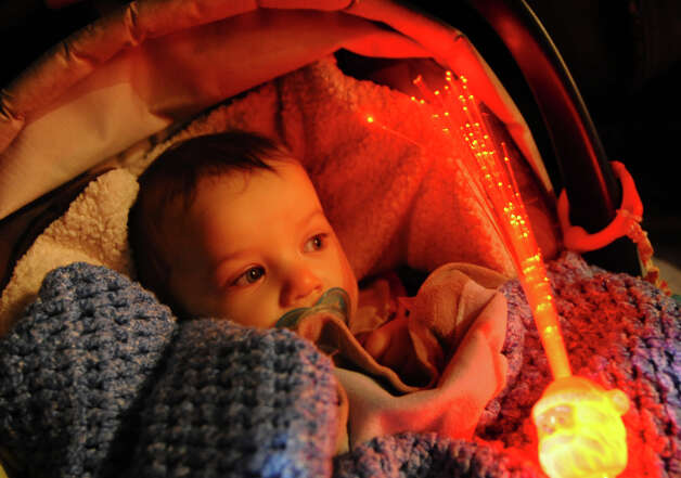 Joseph Jahn, 9 months, stays warm as he and his family attend the annual Christmas Tree Lighting on the Town Hall Green in Fairfield, Conn. on Friday November 30, 2012. Photo: Christian Abraham / Connecticut Post