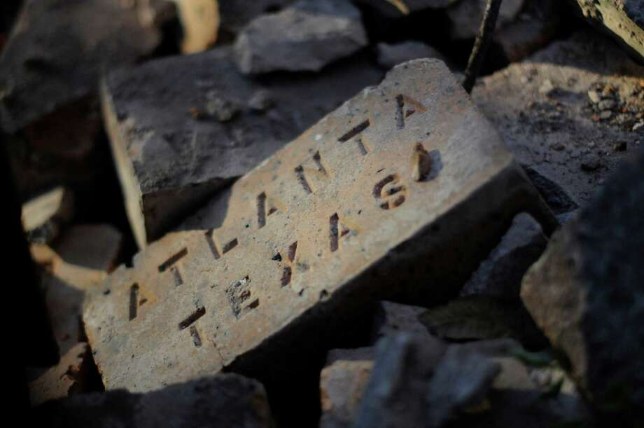 Bricks that once were a part of the facade lay on the ground in Dallas, Thursday, Nov. 29, 2012, next to the apartment building where Lee Harvey Oswald once occupied one of the units. Photo: Benny Snyder, Associated Press / AP