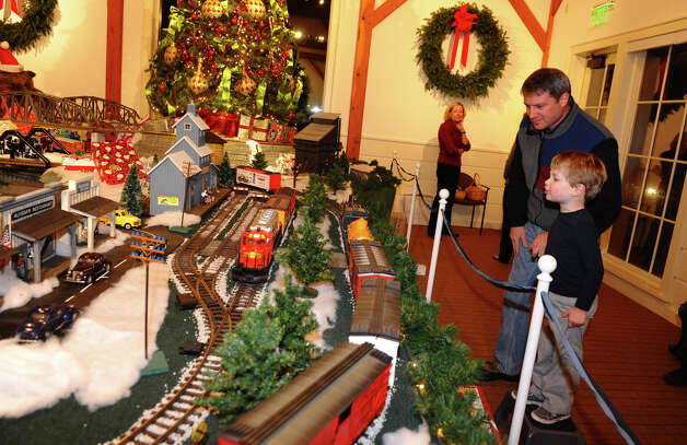 Alex Cruikshank and his son Jack, 3, check out the G Scale trains on display, during the annual Holiday Express Train Show at Fairfield Museum in Fairfield, Conn. on Friday November 30, 2012. Photo: Christian Abraham / Connecticut Post