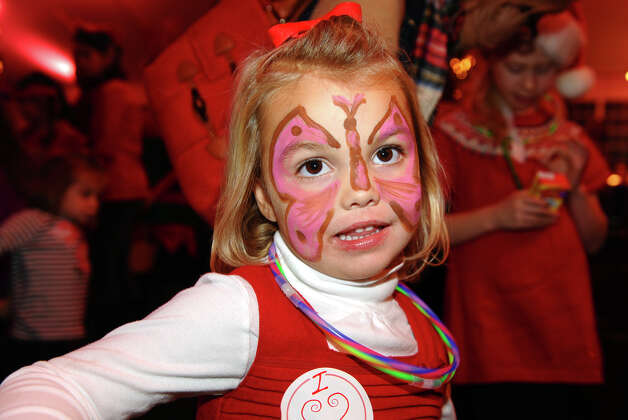 Hayes Wheeler, 4, sports a painted face during the annual Fairfield Christmas Tree Festival at Burr Homestead in Fairfield, Conn. on Friday November 30, 2012. Photo: Christian Abraham / Connecticut Post
