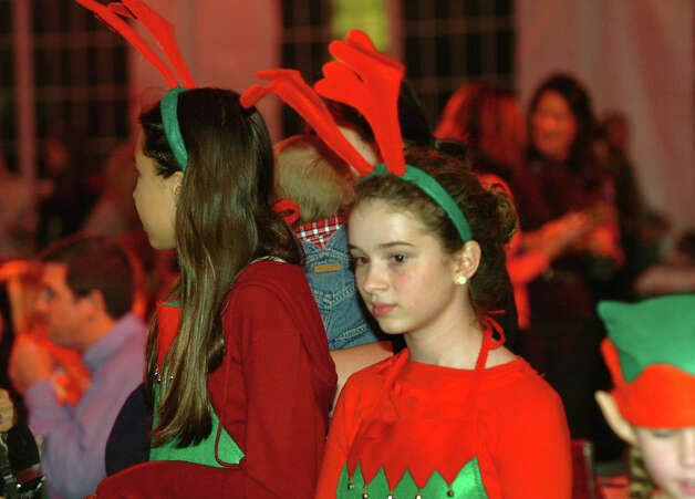 Rosie O'Mahony, 13, volunteers during the annual Fairfield Christmas Tree Festival at Burr Homestead in Fairfield, Conn. on Friday November 30, 2012. Photo: Christian Abraham / Connecticut Post