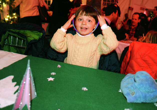 Ryan Waiksnis, 4, plays with his glow necklace, during the annual Fairfield Christmas Tree Festival at Burr Homestead in Fairfield, Conn. on Friday November 30, 2012. Photo: Christian Abraham / Connecticut Post
