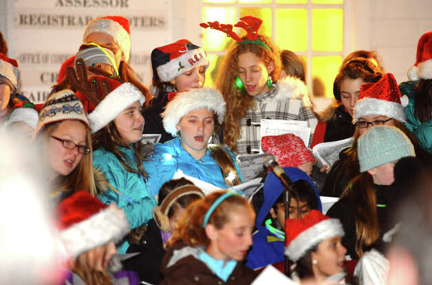 Children from various Fairfield middle schools sing Christmas songs, during the annual Christmas Tree Lighting on the Town Hall Green in Fairfield, Conn. on Friday November 30, 2012. Photo: Christian Abraham / Connecticut Post