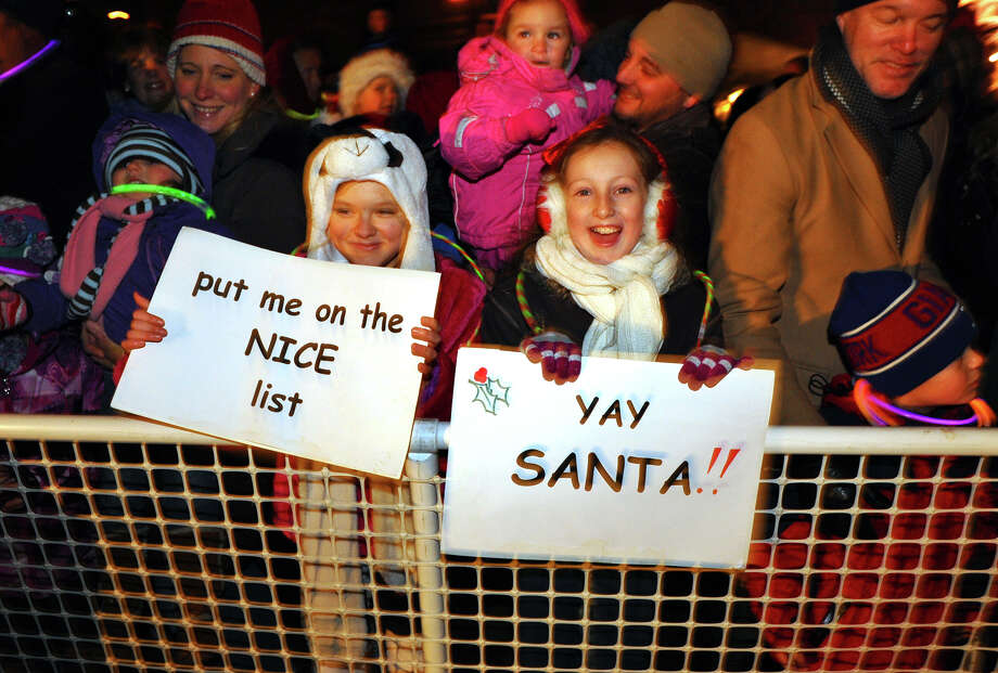 Nadia Roshents, 11, left, and her friend Jessica Lee, 11, wait to greet Santa, during the annual Christmas Tree Lighting on the Town Hall Green in Fairfield, Conn. on Friday November 30, 2012. Photo: Christian Abraham / Connecticut Post