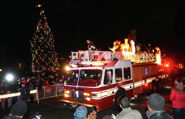 Mrs. Claus and Santa arrive on a Fairfield Fire Department fire engine, during the annual Christmas Tree Lighting on the Town Hall Green in Fairfield, Conn. on Friday November 30, 2012. Photo: Christian Abraham / Connecticut Post