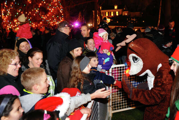 Rudolph the Red Nosed Reindeer greets the children during the annual Christmas Tree Lighting on the Town Hall Green in Fairfield, Conn. on Friday November 30, 2012. Photo: Christian Abraham / Connecticut Post