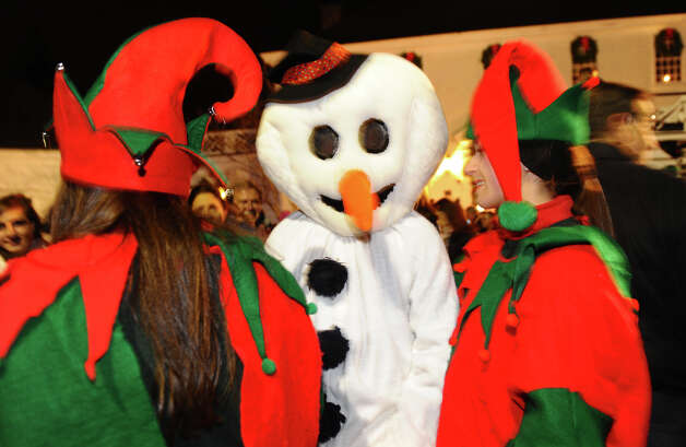"Frost the Snowman and two ""elves"" join in fun during the annual Christmas Tree Lighting on the Town Hall Green in Fairfield, Conn. on Friday November 30, 2012. Photo: Christian Abraham / Connecticut Post"