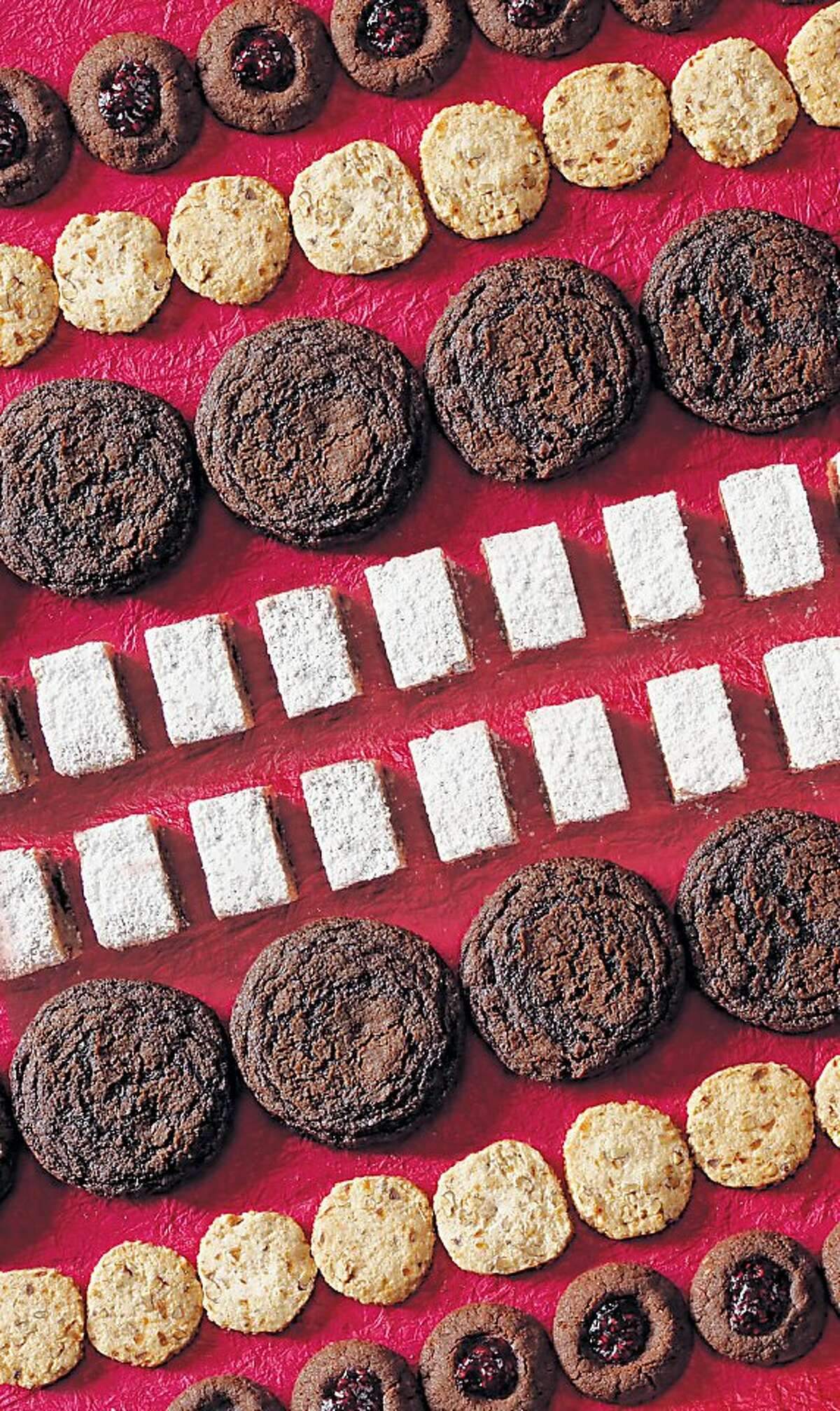 An easy line-up for any holiday baker, whether novice or expert. From top: Chocolate Almond Thumbprints, Spiced Pecan Shortbread, Chocolate Gingersnaps With Chocolate Ganache, Brown Butter Dried Fruit Bars.