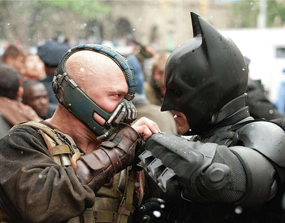 Tom Hardy as Bane and Christian Bale as Batman in The Dark Knight Rises. (Warner Bros. / 2012)