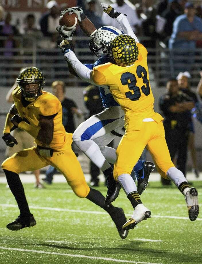 Navasota receiver Austin Collins (2) catches a 23-yard touchdown pass as La Marque defensive back Reggie Franklin (33) defends. Photo: Smiley N. Pool, Houston Chronicle / © 2012  Houston Chronicle