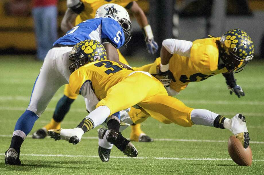 Navasota running back Derrion Randle (5) fumbles as he is hit by La Marque defensive back Reggie Franklin. Photo: Smiley N. Pool, Houston Chronicle / © 2012  Houston Chronicle