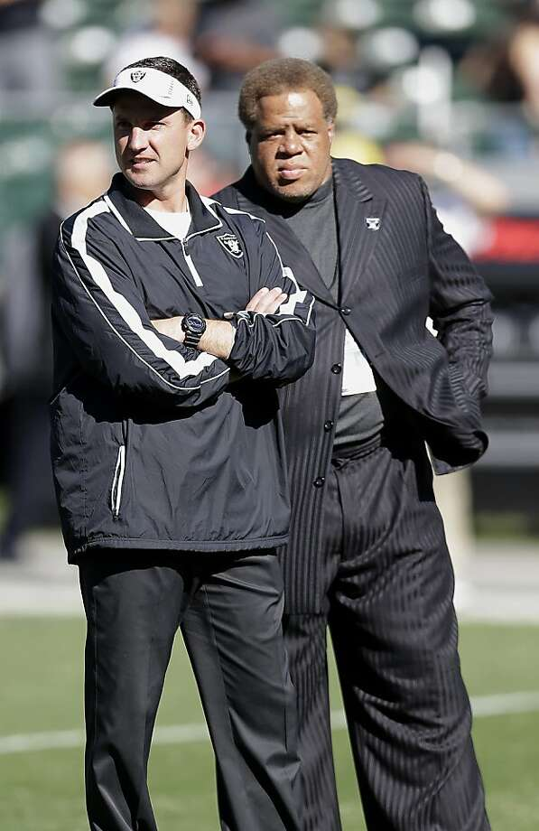 General manager Reggie McKenzie (right) said he is pleased with first-year coach Dennis Allen. Photo: Marcio Jose Sanchez, Associated Press