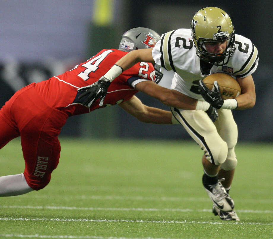 Nederland's Michael Shaw (2) is tackled by Dawson's Chris Hosanna. Photo: Eric Christian Smith, For The Chronicle