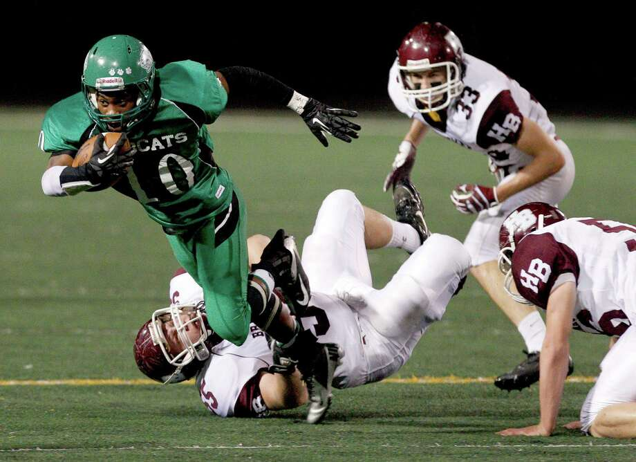 11/30/12: Brain Knowles #10 of the Hempstead Bobcats is tackled by Dyllan Kerr #55 of the Hallettsville Brahmas in a Class 2A Division 1 Playoff game at Traylor Stadium in Rosenberg, Texas. Photo: Thomas B. Shea, For The Chronicle / © 2012 Thomas B. Shea
