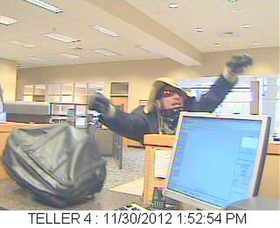 Bank security camera of the suspect. Photo: Picasa, Fort Bend County Crime Stoppers