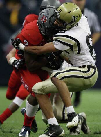Dawson's James White (2) is tackled by Nederland's Bryce Whaley during the first half of a Class 4A Division I high school football playoff game, Friday, November 30, 2012 at Reliant Stadium in Houston, TX. (Eric Christian Smith/For the Chronicle) Photo: Eric Christian Smith, Freelance