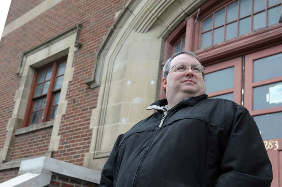 Anthony Capece, executive director of the Central Avenue BID, stands in front of the former St. Patrick's School on Friday Nov. 30, 2012 in Albany, N.Y. The BID purchased the building a year ago for $200,000 and is now weighing ideas from interested potential owners, including local colleges and universities. (Lori Van Buren / Times Union) Photo: Lori Van Buren
