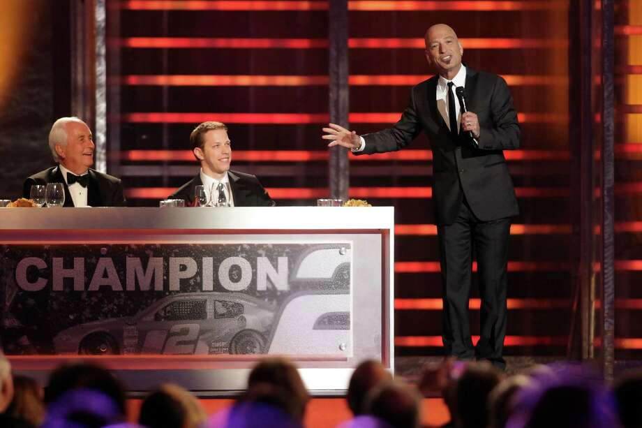 LAS VEGAS, NV - NOVEMBER 30:  Host/Comedian Howie Mandel (R) speaks to Champion Brad Keselowski (C), driver of the #2 Miller Lite Dodge, and team owner Roger Penske (L) during the NASCAR Sprint Cup Series Champion's Awards Ceremony at the Wynn Las Vegas on November 30, 2012 in Las Vegas, Nevada. Photo: John Gurzinski, Getty Images For NASCAR / 2012 Getty Images