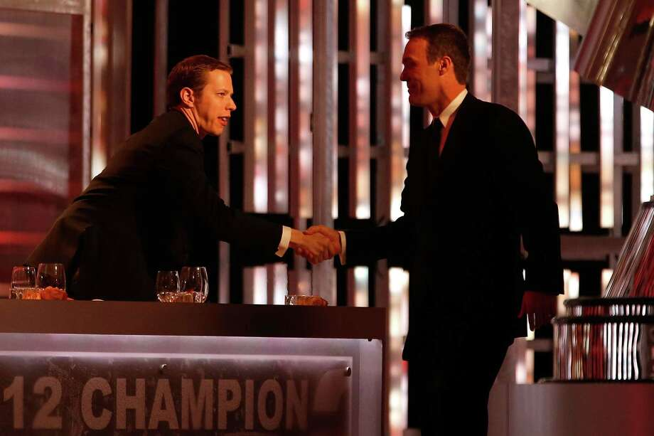 LAS VEGAS, NV - NOVEMBER 30:  NASCAR Sprint Cup Series Champion Brad Keselowski, driver of the #2 Miller Lite Dodge, shakes hands with Kevin Harvick, driver of the #29 Budweiser Chevrolet, during the NASCAR Sprint Cup Series Champion's Awards Ceremony at the Wynn Las Vegas on November 30, 2012 in Las Vegas, Nevada. Photo: Tom Pennington, Getty Images For NASCAR / 2012 Getty Images