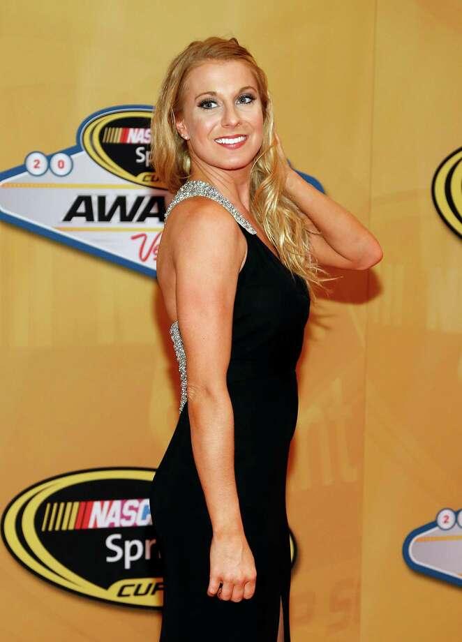 Kaitlyn Vincie arrives at the NASCAR Sprint Cup Series auto racing awards on Friday, Nov. 30, 2012, in Las Vegas. (AP Photo/Isaac Brekken) Photo: Isaac Brekken, Associated Press / FR159466 AP