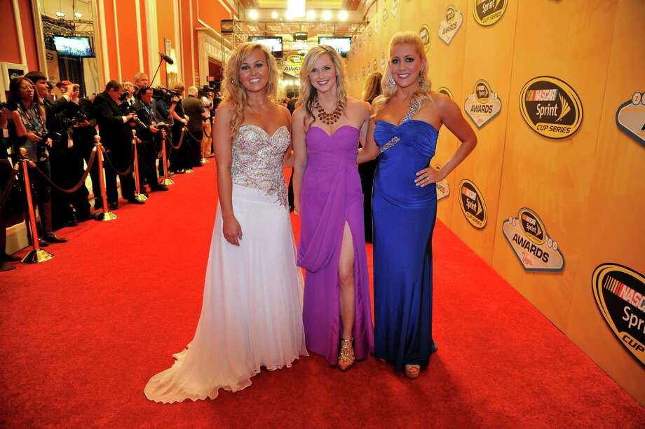 LAS VEGAS, NV - NOVEMBER 30:  (L-R) Miss Sprint Kristen Beat, Kim Coon and Jaclyn Roney arrive on the red carpet for the NASCAR Sprint Cup Series Champion's Awards at the Wynn Las Vegas on November 30, 2012 in Las Vegas, Nevada. Photo: Jeff Bottari, Getty Images For NASCAR / 2012 Getty Images