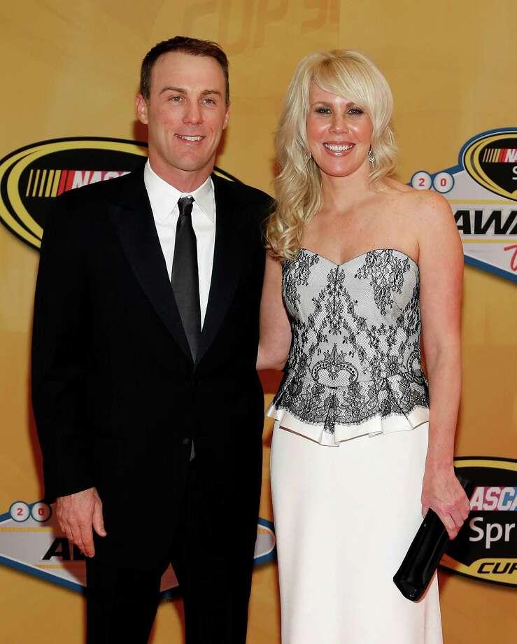 Kevin Harvick and DeLana Harvick arrive at the NASCAR Sprint Cup Series auto racing awards Friday, Nov. 30, 2012, in Las Vegas. (AP Photo/Isaac Brekken) Photo: Isaac Brekken, Associated Press / FR159466 AP