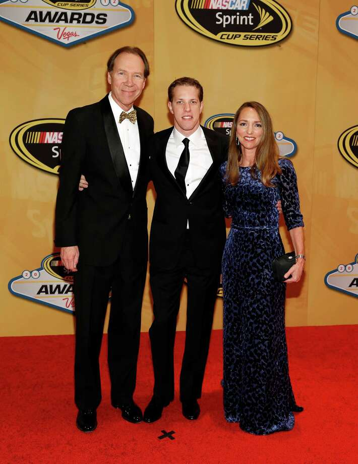Sprint Nextel CEO Dan Hesse, left, series champion Brad Keselowski and Diane Hesse arrive at the NASCAR Sprint Cup Series auto racing awards, Friday, Nov. 30, 2012, in Las Vegas. (AP Photo/Isaac Brekken) Photo: Isaac Brekken, Associated Press / FR159466 AP