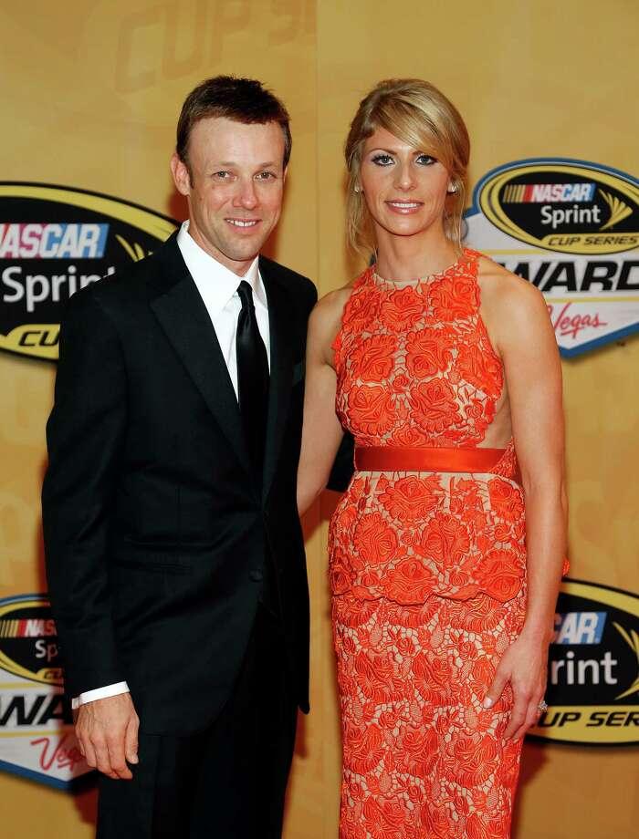 Matt Kenseth and Katie Kenseth arrive at the NASCAR Sprint Cup Series auto racing awards on Friday, Nov. 30, 2012, in Las Vegas. (AP Photo/Isaac Brekken) Photo: Isaac Brekken, Associated Press / FR159466 AP
