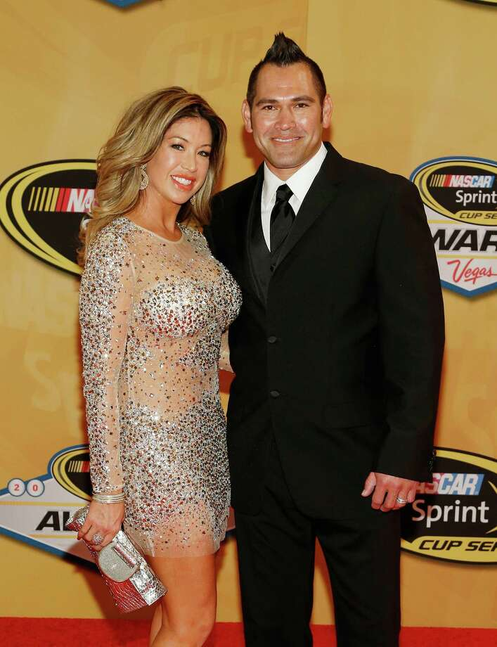 Johnny Damon and Michelle Mangan arrive at the NASCAR Sprint Cup Series auto racing awards on Friday, Nov. 30, 2012, in Las Vegas. (AP Photo/Isaac Brekken) Photo: Isaac Brekken, Associated Press / FR159466 AP