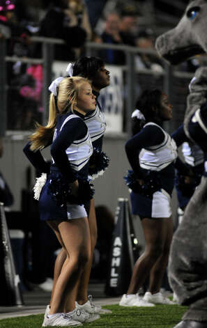 West Orange-Stark freshman cheerleader Olivia Basinger, 14, dances on the sideline during the Mustang's Class 3A Division II regional matchup versus the Lorena Leopards at Waller ISD Stadium on Friday. Photo by Jerry Baker
