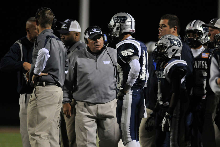 West Orange-Stark Head Coach Cornel Thompson, center, pumps up senior wide receiver Chase Rutledge during the second quarter of the Mustang's Class 3A Division II regional matchup with the Lorena Leopards at Waller ISD Stadium on Friday. Photo by Jerry Baker