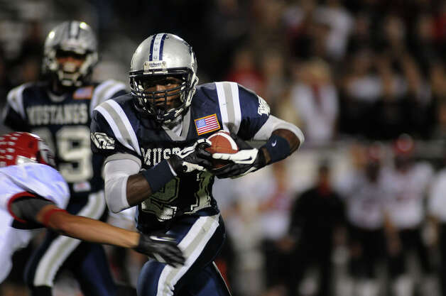 West Orange-Stark senior tailback Colin Janice runs for yardage after catching a pass on a fake punt in the second quarter of the Mustang's Class 3A Division II regional matchup with the Lorena Leopards at Waller ISD Stadium on Friday. Photo by Jerry Baker