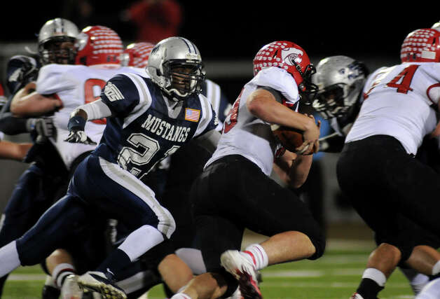 West Orange-Stark senior defensive lineman Colin Janice, left, chases Lorena junior quarterback Harris Coleman during their Class 3A Division II regional matchup at Waller ISD Stadium on Friday. Photo by Jerry Baker