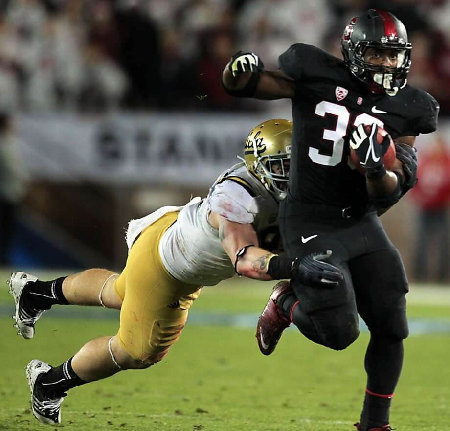 Stanford Stepfan Taylor escapes a tackle for a 33 yard gain in the first quarter Friday Nov. 30, 2012, in the Pack 12 championship game with UCLA in Stanford, Calif. Photo: Lance Iversen, The Chronicle